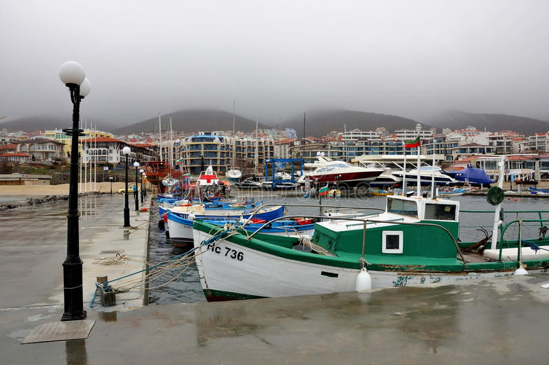 The marina, many different boats, view on mountains and waterfront, fog. Gy weather. Sveti Vlas, Bulgaria stock image