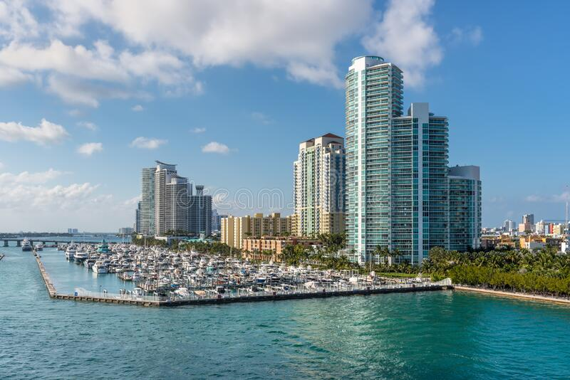 Marina Meloy Channel, Miami, Florida, United States of America. Miami, FL, United States - April 28, 2019: Luxury high-rise condominiums overlooking boat parking stock photos