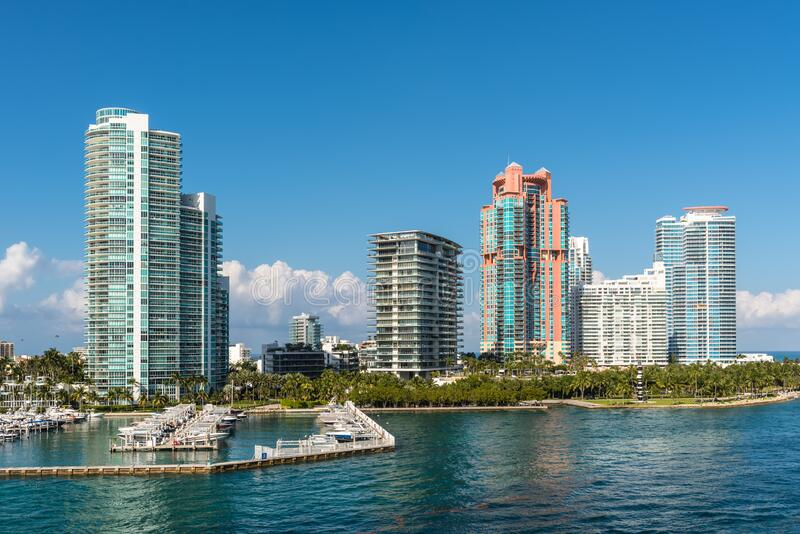 Marina Meloy Channel, Miami, Florida, United States of America. Miami, FL, United States - April 28, 2019: Luxury high-rise condominiums overlooking boat parking royalty free stock photos