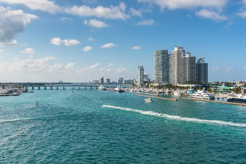 Marina Meloy Channel, Miami, Florida, United States of America. Miami, FL, United States - April 28, 2019: Luxury high-rise condominiums overlooking boat traffic royalty free stock photography