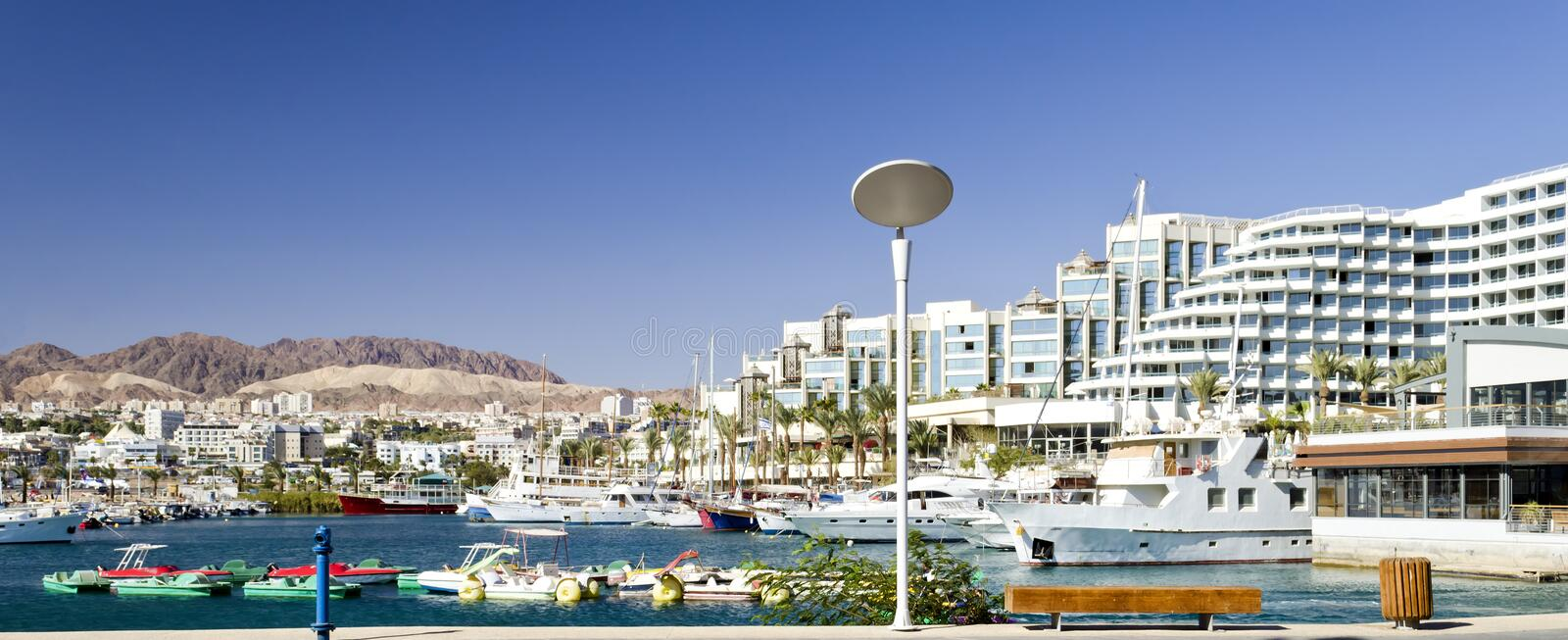 Marina near resort hotels in Eilat, Israel. The shot was taken at the northern beach of Eilat - popular resort city of Israel royalty free stock image