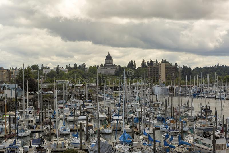 Marina in Olympia Washington Waterfront Moorage. Marina with boats moored in Olympia Washington State by Capitol building on a cloudy day stock photo