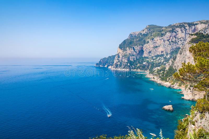 Marina Piccola and Monte Solaro, Capri Island, Italy. Daylight view of Marina Piccola and Monte Solaro, Capri Island, Italy. Sunny summer weather, clear blue sea royalty free stock photo