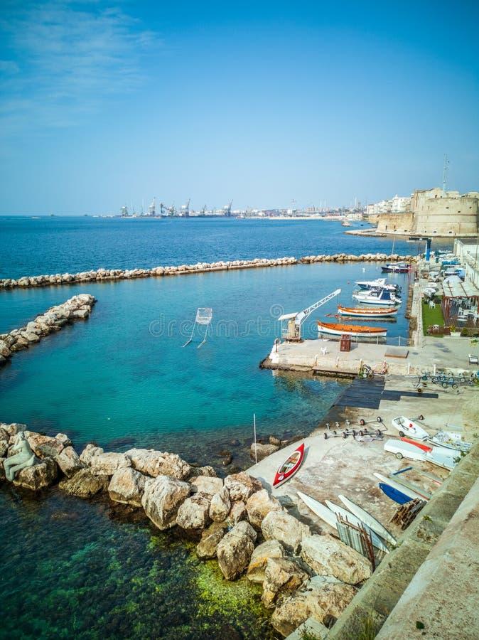 Marina with small boats on the coast on the seafront of Taranto in Italy. royalty free stock photo