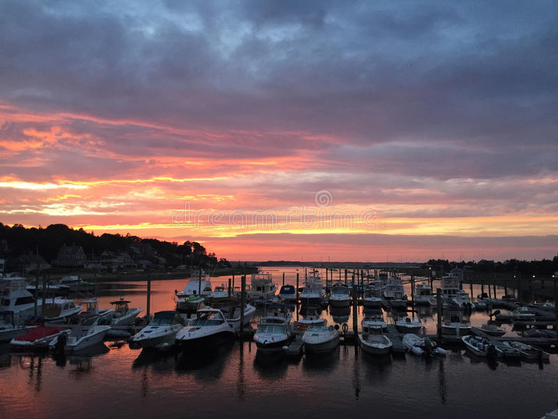Marina on South River in Marshfield Massachusetts. Sunset over marina on South River at Hummarock beach royalty free stock image