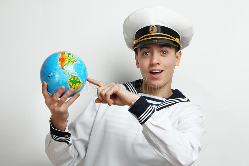 Marinaio che tiene un globo immagini stock libere da diritti