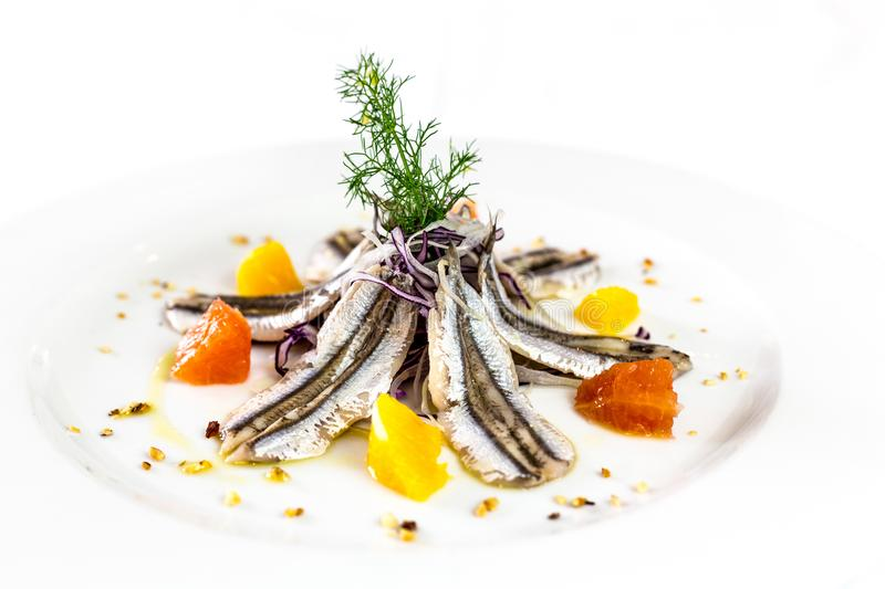 Marinated anchovies. Gourmet restaurant italian food. white back. Marinated anchovies with herbs, seafood, Gourmet restaurant italian food. white background royalty free stock photography