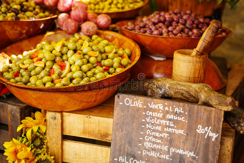 Marinated garlic and olives on provencal street market in Proven stock image