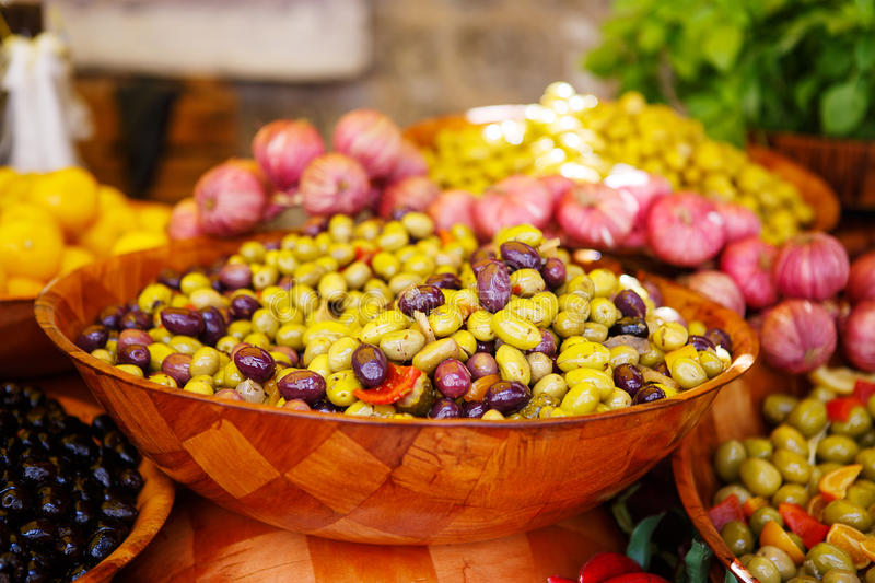 Marinated garlic and olives on provencal street market in Proven. Ce, France. Selling and buying stock photography
