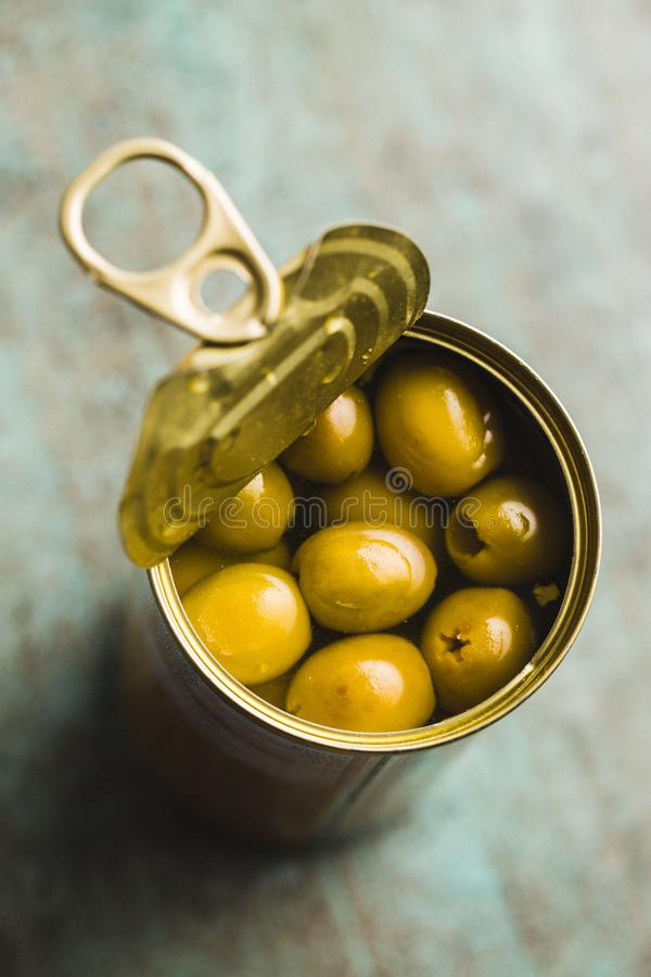 Marinated green olives in can stock image