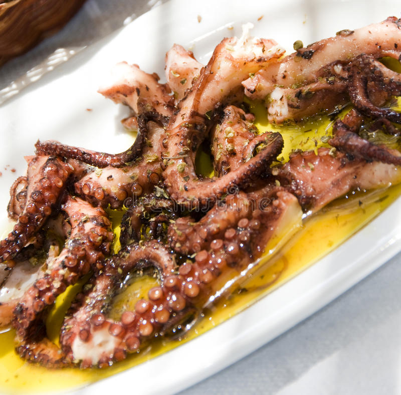 Marinated grilled octopus taverna greek islands stock photography