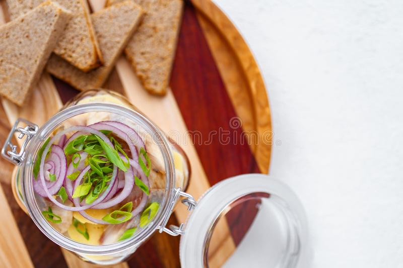 Marinated herring with boiled potato and red onion stock photography