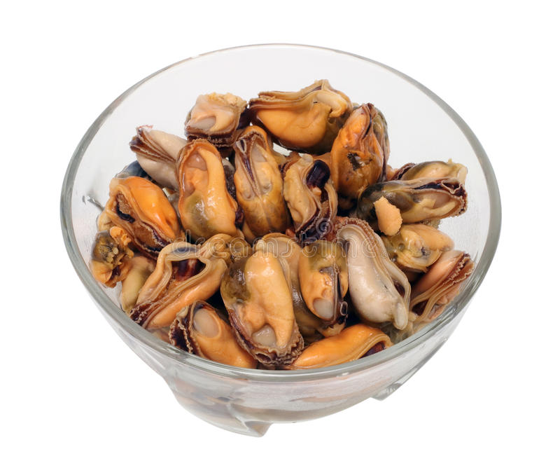 Marinated mussel isolated. Marinated sea mollusks mussel in glass table isolated with path stock photo