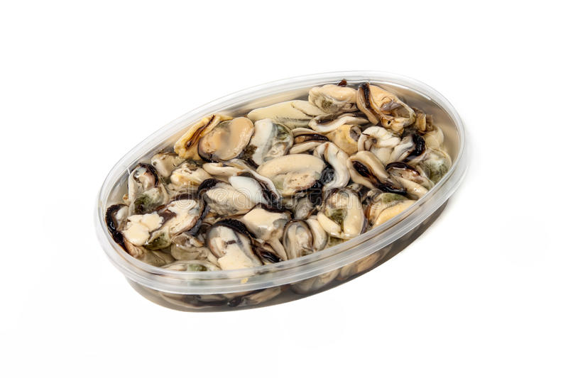 Marinated mussels on a white background stock photo