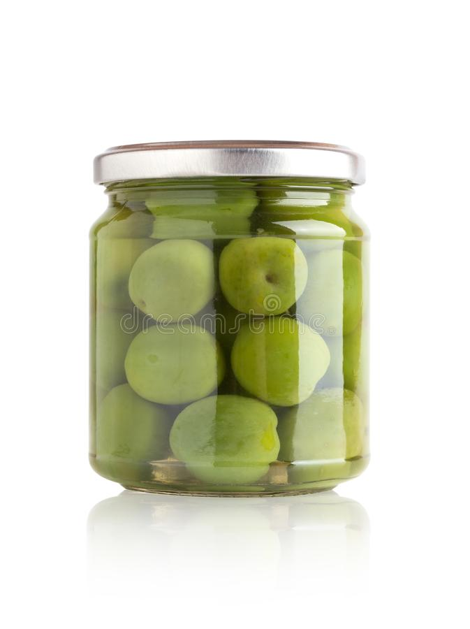 Marinated olives in a glass jar. royalty free stock photo