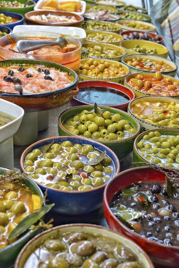 Marinated olives with herbs in a market. stock photo