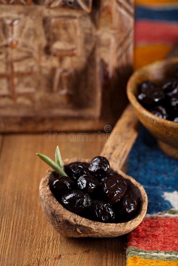 Marinated Olives In Old Spoon With Moroccan  Ornament On Wood Stock Photo