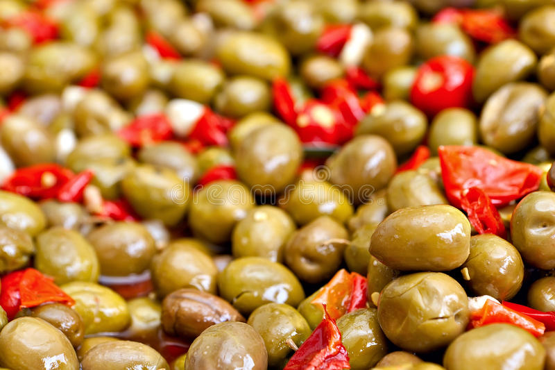 Marinated olives. Marinated pitted green olives. Traditional Mediterranean relish royalty free stock images