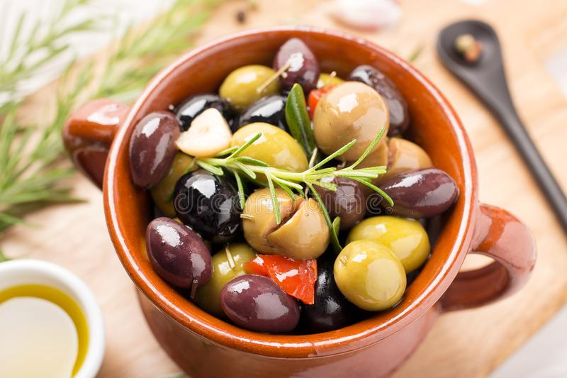 Marinated olives in a rustic bowl royalty free stock photo