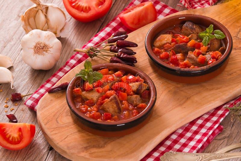 Marinated pork loin in tomato sauce. royalty free stock photo