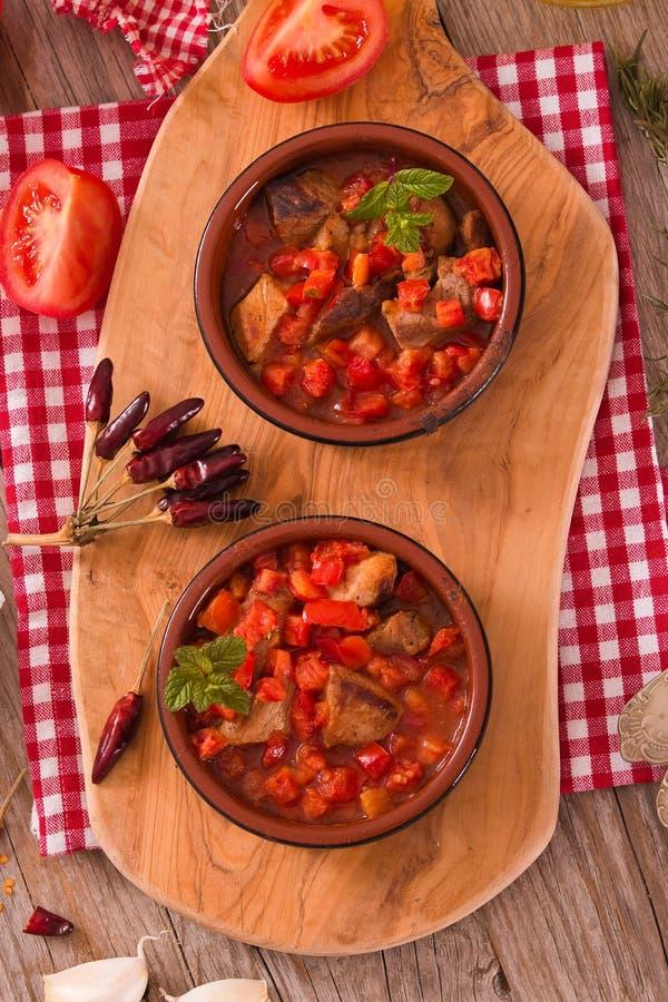 Marinated pork loin in tomato sauce. royalty free stock photos