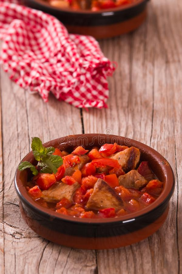 Marinated pork loin in tomato sauce. royalty free stock image
