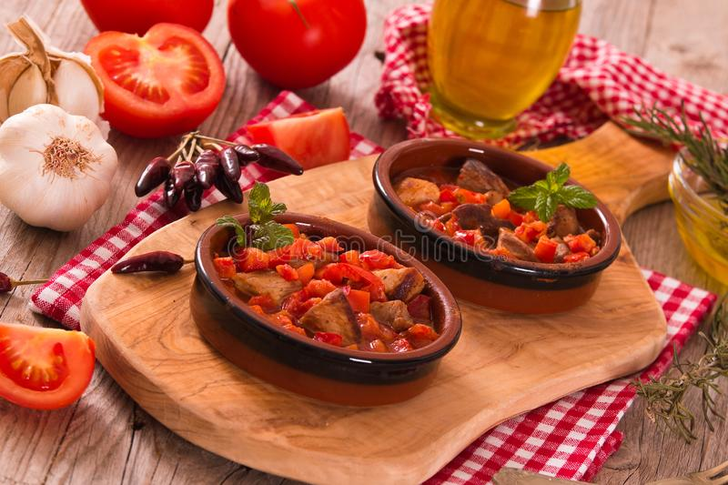 Marinated pork loin in tomato sauce. royalty free stock images