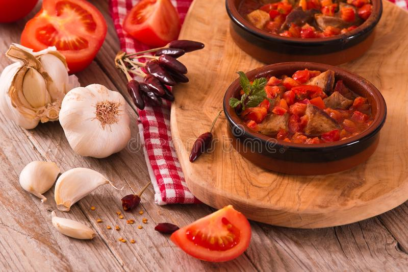 Marinated pork loin in tomato sauce. stock photography