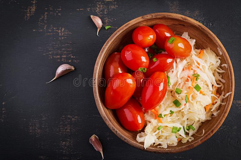Marinated, sauerkraut with pickled tomatoes and onions. Top view royalty free stock photos