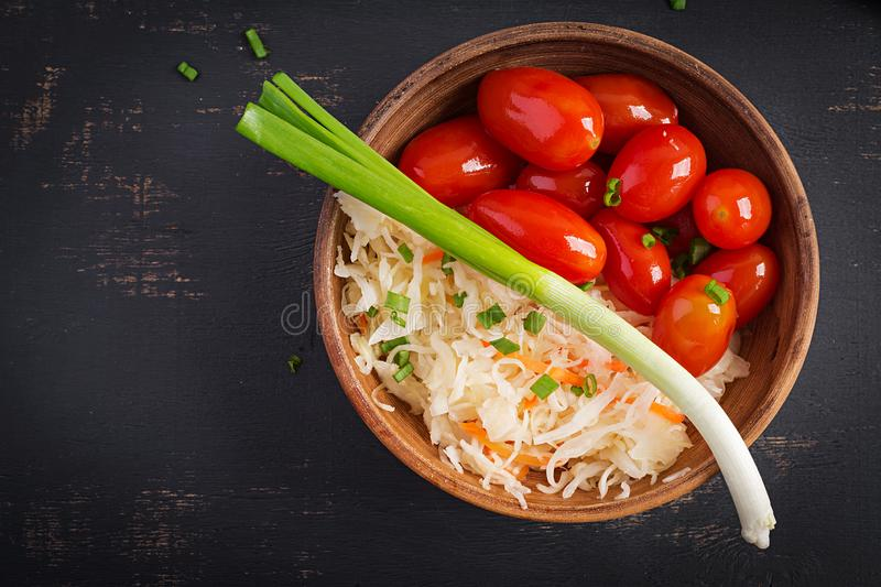 Marinated, sauerkraut with pickled tomatoes and onions. Top view stock photo