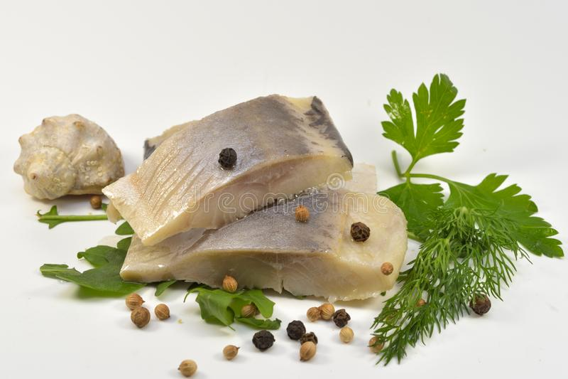 Marinated Skinless Mackerel on Rucola Leaves and Herbs. Isolated on white background stock photo