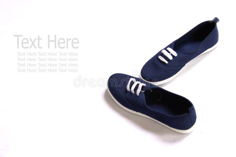 Marinblåa skor arkivfoton