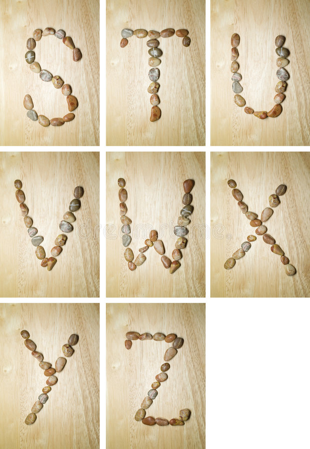 Marine alphabet S-Z. Summertime english alphabet made of marine stones. background is rubber tree (seringa royalty free stock photography