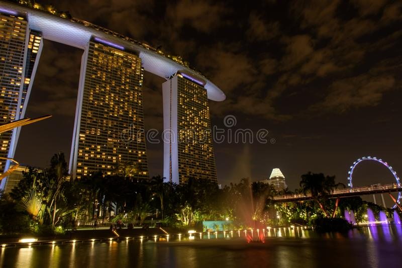 Marine bay near the Gardens by the Bay. Night view of the light tree show in Singapore. Singapore, 19, April, 2018 : Marine bay near the Gardens by the Bay stock images