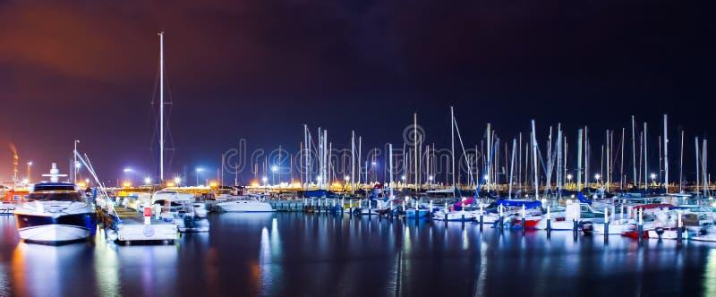 Marine boats night water sea lights colorful royalty free stock photo