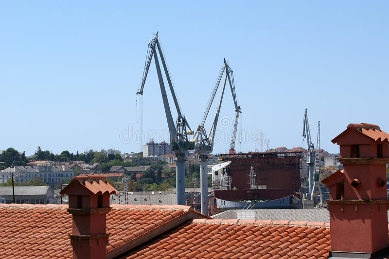Marine cargo port. Cranes. Pula, Croatia royalty free stock photography