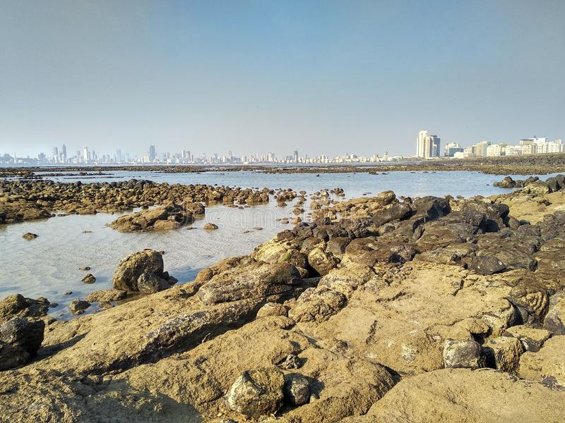 Marine Drive in Mumbai from sea side of Geeta Nagar. It is Image of Marine Drive Mumbai Maharashtra India Taken from sea side of slum area named as Geeta Nagar stock photography