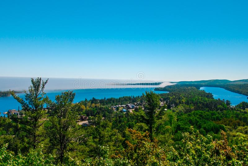 Marine Fog rolling in over Stunning Lake Superior. Marine Fog rolling in near Coper Harbor on the coast of Lake Superior`s crystal cold blue waters in Upper stock photography