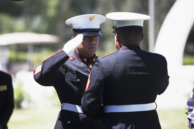 Marine folds flag at Memorial Service for fallen US Soldier, PFC Zach Suarez, Honor Mission on Highway 23, drive to Memorial stock photos