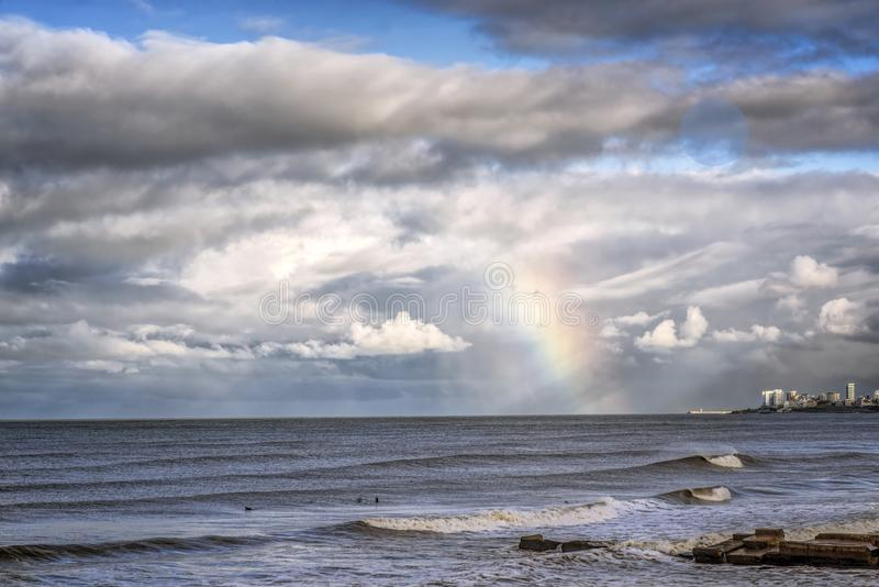 Marine landscape in Mar del Plata Argentina  Rainbow on the coast. Rainbow on the coast , Mar del Plata , Argentina royalty free stock image