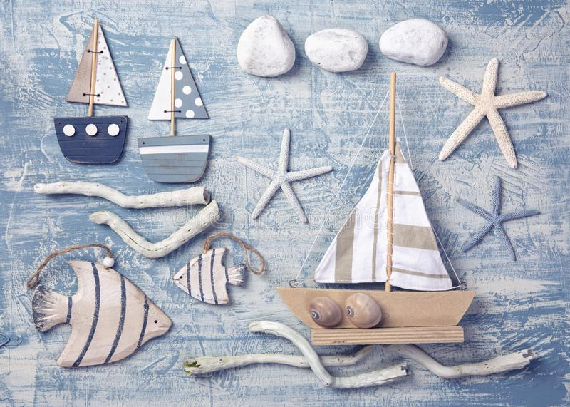 Marine life decoration on a wooden background. Top view stock photos