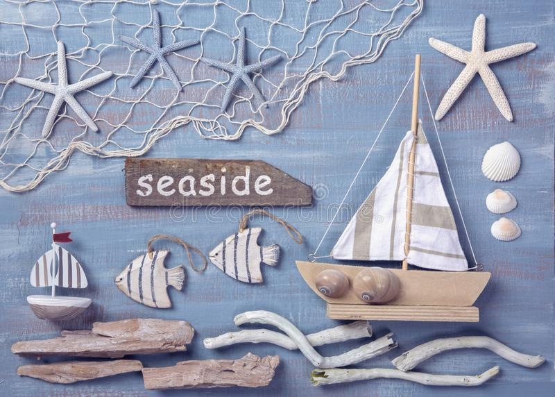 Marine life decoration on a wooden background. Top view stock photography