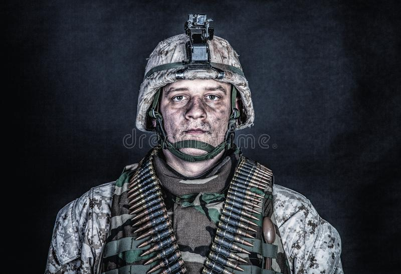Marine machine gunner with ammo belts on chest stock photography