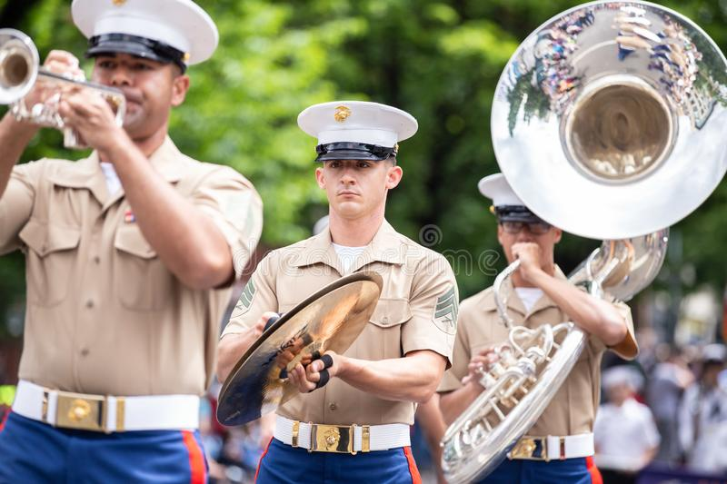 Marine men with musical instruments. Portland, OR / USA - June 11 2016: Army men in a marching band with various musical instruments. Grand floral parade stock images