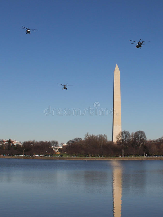 Marine One & Escort Fly By Washington Monument en route to White House. Obama family aboard Marine One, flying by the Washington Monument on their return to the stock image