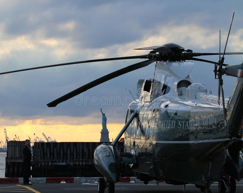 Marine One VH-3D on the Wall Street Heliport with Statue of Liberty in the background stock photo