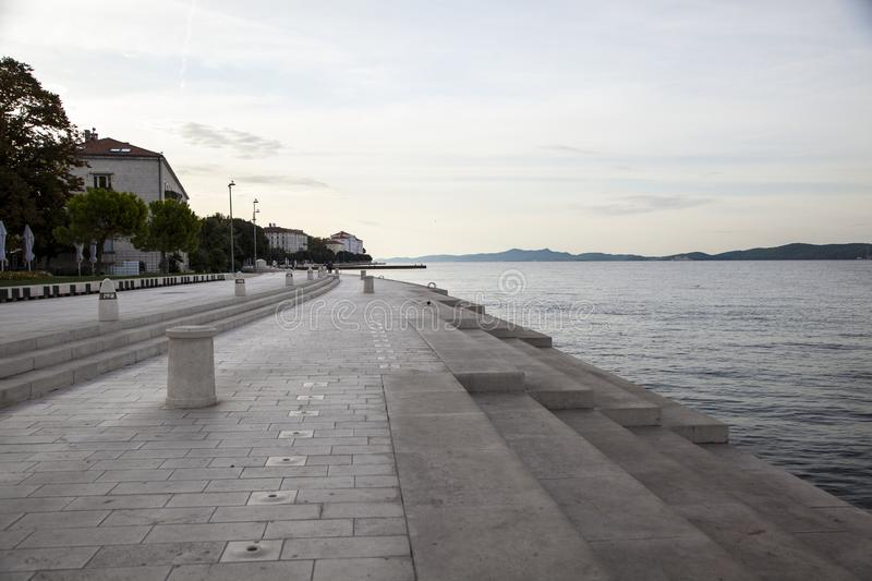 . Marine organ in Zadar, Croatia. The Zadar Sea Organ is a unique architectural creation, an interesting and original blend of architecture and music. Unlike stock photo