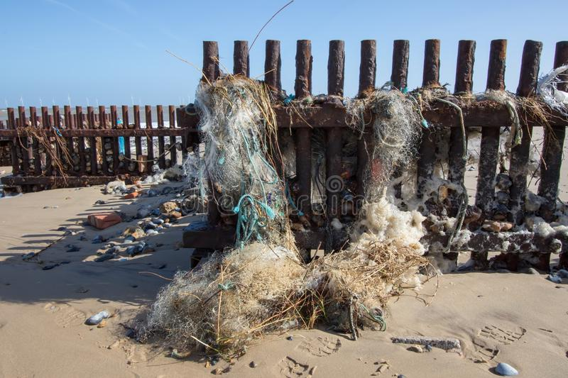 Marine pollution. Fine nylon plastic tangled sea fishing net. A hazard to wildlife, washed up on a beach in UK stock photo