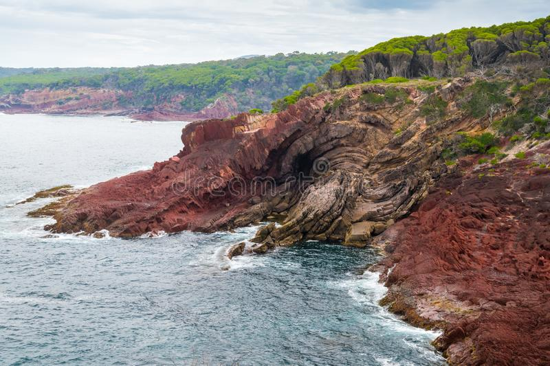 Marine red folded rocks in Ben Boyd National Park. NSW, Australia royalty free stock photo