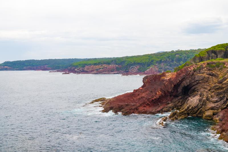Marine red folded rocks in Ben Boyd National Park. NSW, Australia royalty free stock photos